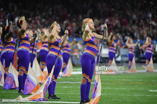 The Clemson Tiger flag bearers perform with the band before the College Football Playoff Semifinal at the Allstate Sugar Bowl between the Alabama...