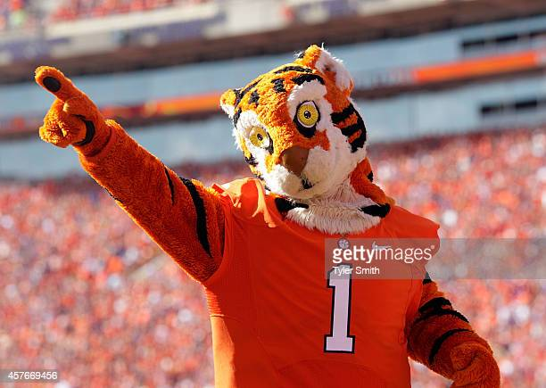 The Clemson Tiger mascot cheers on fans during the game against the Louisville Cardinals at Memorial Stadium on October 11 2014 in Clemson South...