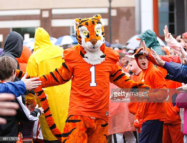 The Clemson Tiger mascot greets fans during the Tigerwalk prior to the game between the Clemson Tigers and Notre Dame Fighting Irish at Clemson...