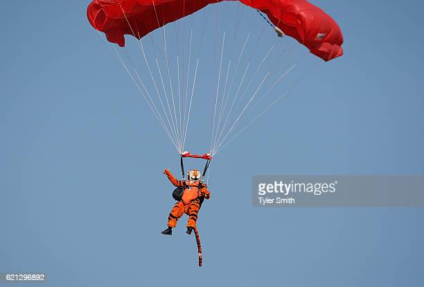 The Clemson Tiger mascot parachutes into the game against the Syracuse Orange at Memorial Stadium on November 5 2016 in Clemson South Carolina