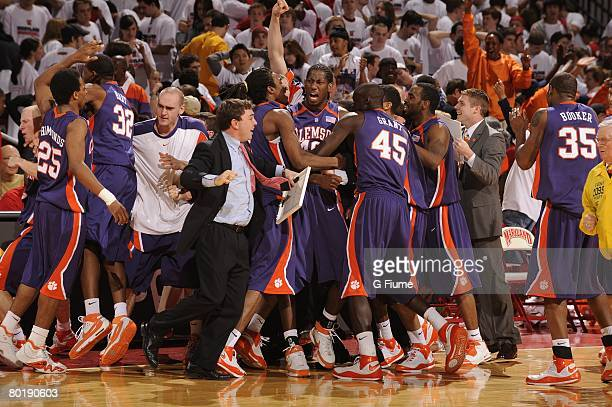 The Clemson Tigers celebrate a 73-70 victory against the Maryland Terrapins at the Comcast Center on March 2, 2008 in College Park, Maryland.