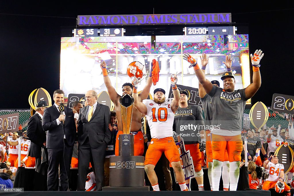 The Clemson Tigers celebrate after defeating the Alabama Crimson Tide 35-31 in the 2017 College Football Playoff National Championship Game at Raymond James Stadium on January 9, 2017 in Tampa, Florida.