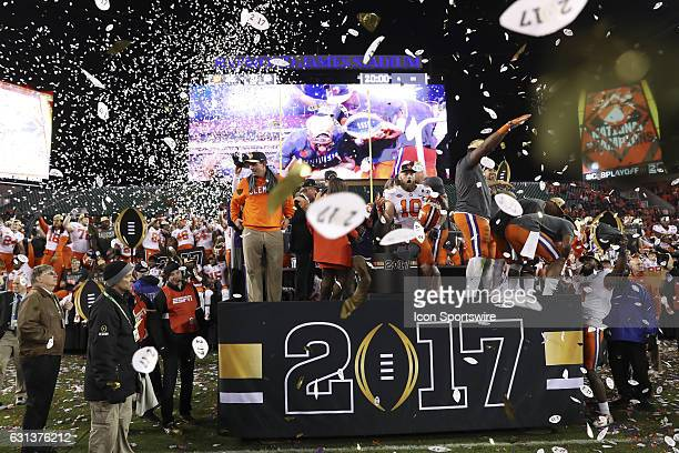 The Clemson Tigers celebrate as confetti rains down after the 2017 College Football National Championship Game between the Clemson Tigers and Alabama...