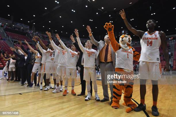 The Clemson Tigers celebrate their 7968 win over the New Mexico State Aggies in the first round of the 2018 NCAA Men's Basketball Tournament at...