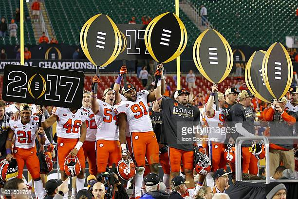The Clemson Tigers celebrate their victory at the conclusion of the National Championship game between the Alabama Crimson Tide and Clemson Tigers on...
