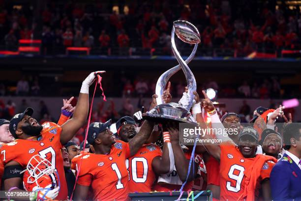 The Clemson Tigers celebrate with the trophy after defeating the Notre Dame Fighting Irish during the College Football Playoff Semifinal Goodyear...