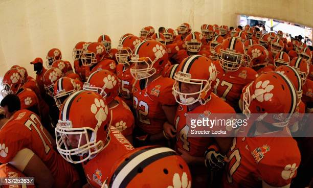 The Clemson Tigers gather n the tunnel as they get set to take the field against the West Virginia Mountaineers during the Discover Orange Bowl at...
