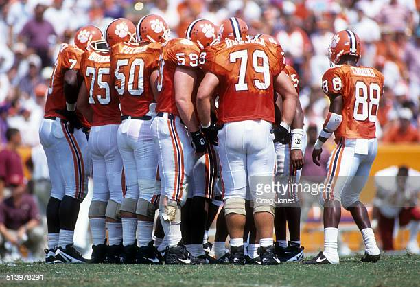 The Clemson Tigers huddle during an NCAA game against the Florida State Seminoles on September 9 1995 at Memorial Stadium in Clemson South Carolina...