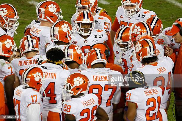 The Clemson Tigers huddle during the second half of the 2017 College Football Playoff National Championship Game against the Alabama Crimson Tide at...