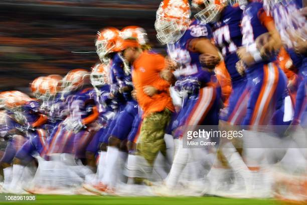 The Clemson Tigers link arms and walk toward their end zone for their traditional face off prior to their football game against the Duke Blue Devils...