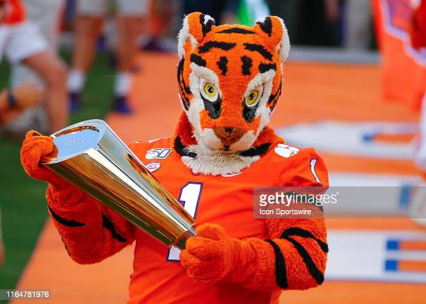 The Clemson Tigers mascot brings the national championship trophy into the stadium prior to the Georgia Tech Yellow Jackets v Clemson Tigers game on...