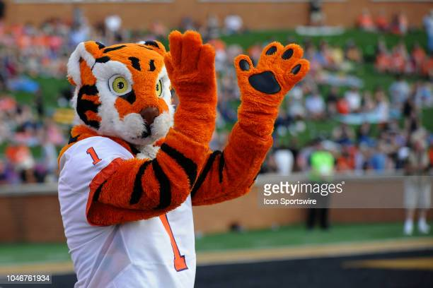 The Clemson Tigers mascot claps his hands on the sideline after a play during the college football game between Clemson and Wake Forest on October 06...