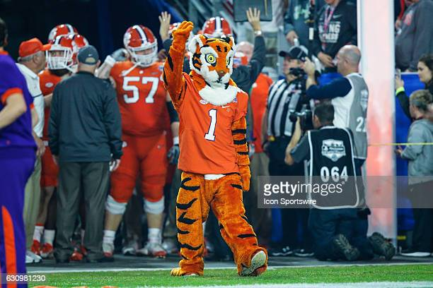 The Clemson Tigers mascot incites the crowd before the Playstation Fiesta Bowl college football game between the Ohio State Buckeyes and the Clemson...