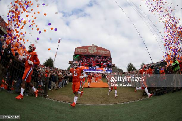 The Clemson Tigers run onto the field before their game against the Florida State Seminoles at Memorial Stadium on November 11 2017 in Clemson South...