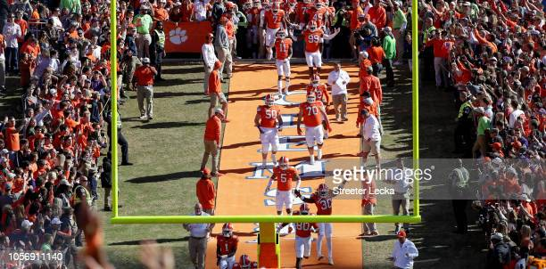 The Clemson Tigers run onto the field prior to their game against the Louisville Cardinals at Clemson Memorial Stadium on November 3 2018 in Clemson...