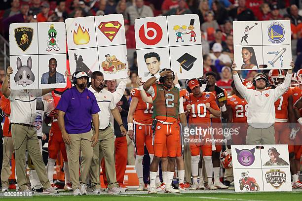 The Clemson Tigers sidelines holds up play cards during the Playstation Fiesta Bowl against the Ohio State Buckeyes at University of Phoenix Stadium...