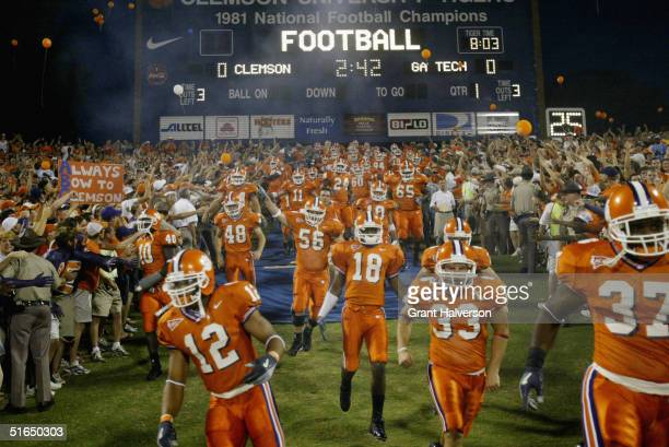 The Clemson University Tigers football team runs onto the field before facing the Georgia Tech Yellow Jackets during an Atlantic Coast Conference...