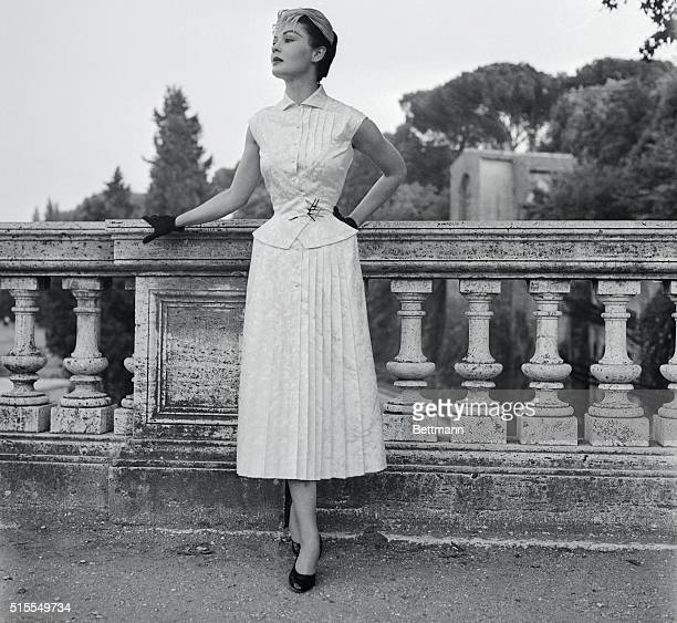 The clepsydra line created for autumn winter 195455 by the Fontana sisters of Rome is displayed clearly in this cocktail dress in silk brocade with...