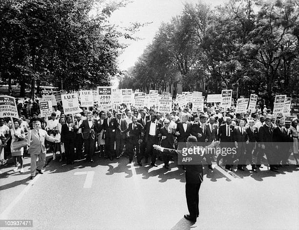 The clergyman and civil rights leader Martin Luther KIng and other black and white civil right leaders march 28 August 1963 on the Mall in Washington...