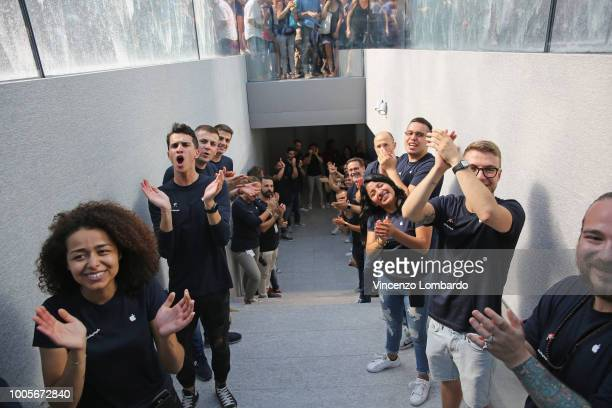 The clerks applaud the Apple store opening in Milan at Piazza Liberty on July 26 2018 in Milan Italy