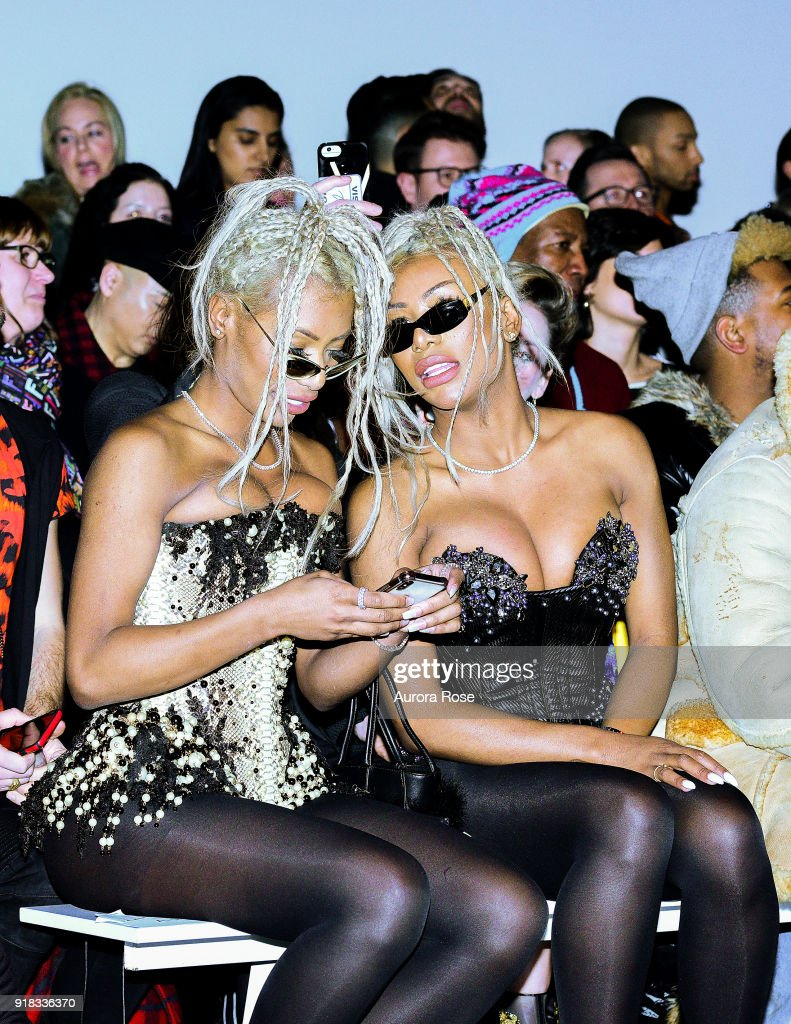 The Clermont Twins sit Front Row at The Blonds Runway show at Spring Studios on February 13, 2018 in New York City.