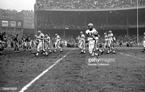 The Cleveland Browns offense moves to the line of scrimmage during a game against the New York Giants at Yankee Stadium on December 12, 1964 in New...