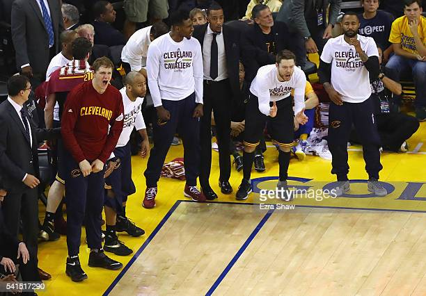 The Cleveland Cavaliers bench reacts during the first half against the Golden State Warriors in Game 7 of the 2016 NBA Finals at ORACLE Arena on June...