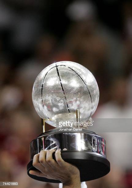 The Cleveland Cavaliers celebrate with the Eastern Conference Trophy after their 9882 win against the Detroit Pistons in Game Six of the Eastern...