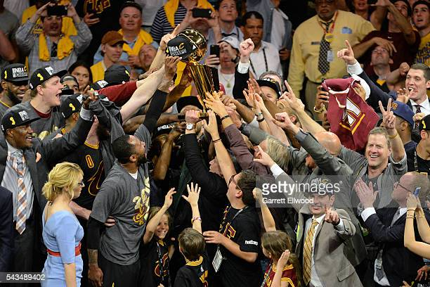 The Cleveland Cavaliers celebrate with the Larry O'Brien NBA Championship Trophy after winning Game Seven of the 2016 NBA Finals against the Golden...