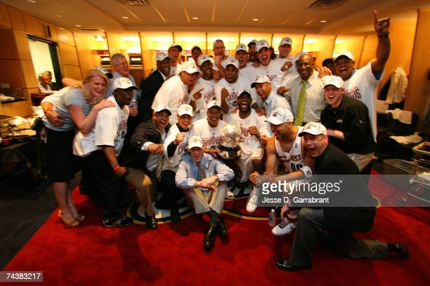 The Cleveland Cavaliers gather for a group shot in the locker room after defeating the Detroit Pistons in Game Six of the Eastern Conference Finals...