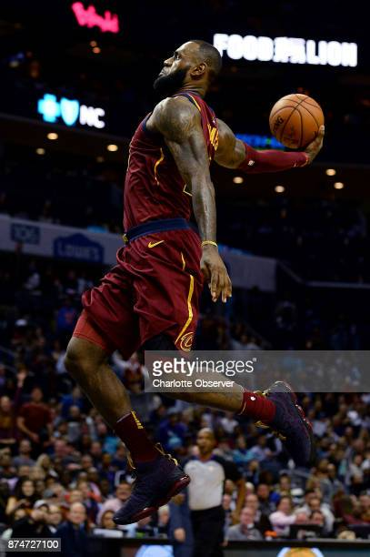 The Cleveland Cavaliers' Lebron James cocks the ball back as he prepares to throw down a onehanded dunk against the Charlotte Hornets during...