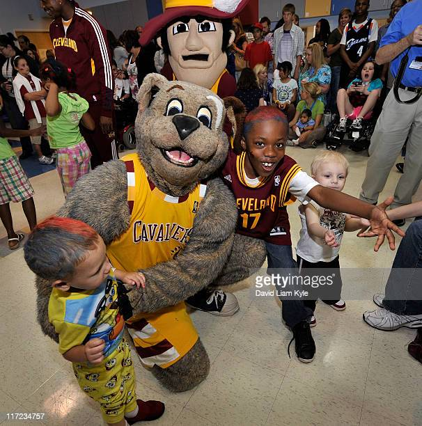 The Cleveland Cavaliers mascot Moondog plays with some children from the Cleveland Clinic Children's Hospital for Rehabilitation at the unveiling of...