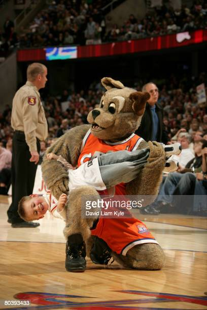 The Cleveland Cavaliers mascot Moondog uses a fan as a prop rather than his usual air guitar during a break in the action against the New Orleans...
