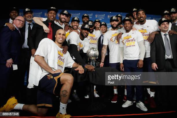The Cleveland Cavaliers pose with the Eastern Conference Championship Trophy after defeating the Boston Celtics 135-102 in Game Five of the 2017 NBA...