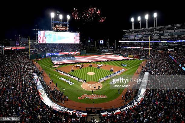 The Cleveland Indians and the Chicago Cubs stands during the national anthem prior to Game One of the 2016 World Series at Progressive Field on...