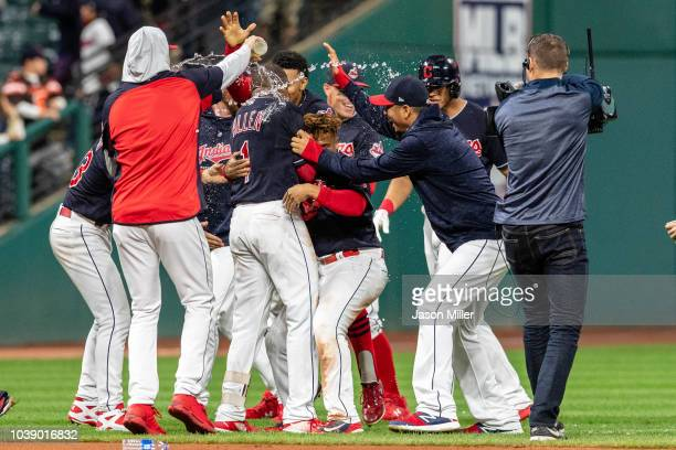 the Cleveland Indians celebrate after Greg Allen hit an RBI walkoff single to defeat the Boston Red Sox during the eleventh inning at Progressive...