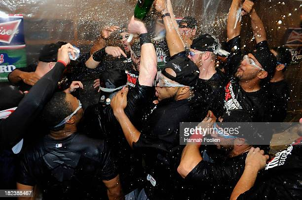 The Cleveland Indians celebrate with champagne in the clubhouse after a win of the game against the Minnesota Twins on September 29 2013 at Target...