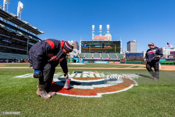 The Cleveland Indians grounds crew preps the field prior to the Opening Day game against the Chicago White Sox at Progressive Field on April 1 2019...