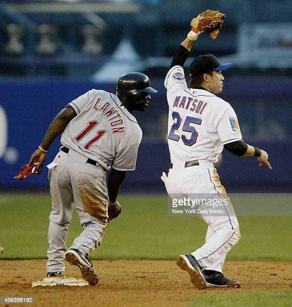 The Cleveland Indians' Matt Lawton is caught trying to steal second by the New York Mets' Kazuo Matsui in the third inning at Shea Stadium The Mets...