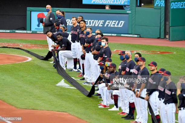 The Cleveland Indians observe a moment of silence prior to the Opening Day game against the Kansas City Royals at Progressive Field on July 24 2020...