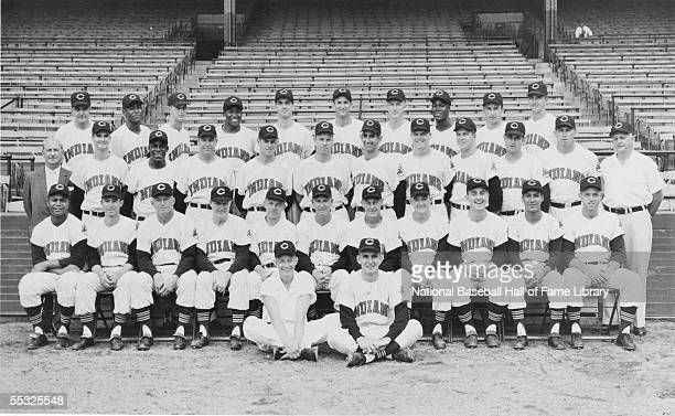 The Cleveland Indians pose for a team photo at Cleveland Municipal Stadium in Cleveland, Ohio. Front Equipment Manager Al Shapanus, Batboy Chuck...