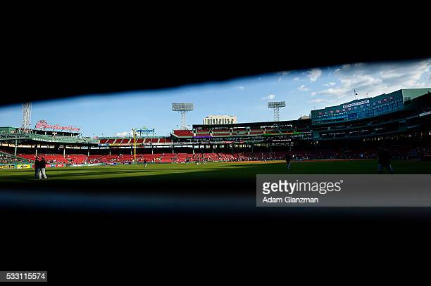 The Cleveland Indians practice in the outfield as seen from inside the Green Monster before the game between the Boston Red Sox and the Cleveland...