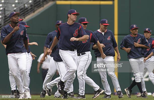 The Cleveland Indians warm up before the MLB game against the Cincinnati Reds on June 13 2004 at Jacobs Field in Cleveland Ohio The Indians defeated...