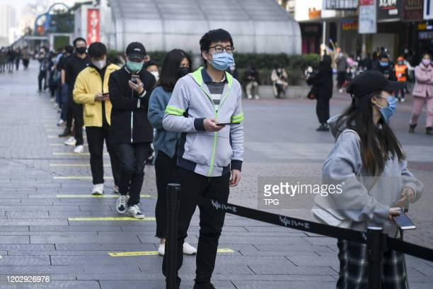 The clients are lining up with long distance to buy milk tea during the outbreaks of novel coronavirus pneumonia on 23th February, 2020 in...