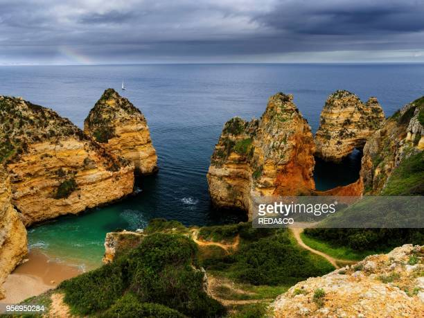 The cliffs and sea stacks of Ponta da Piedade at the rocky coast of the Algarve in Portugal Europe Southern Europe Portugal March