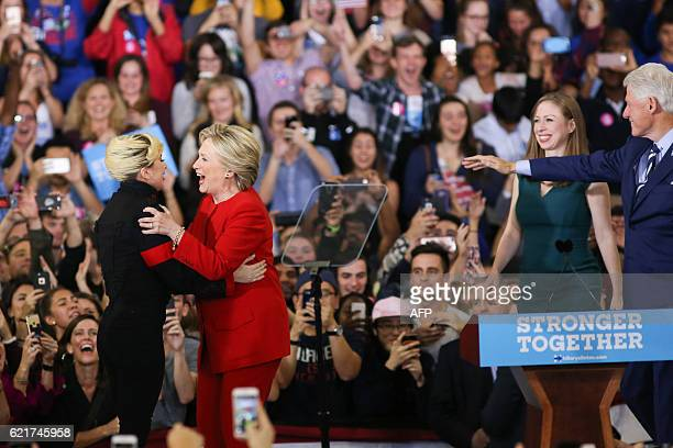 The Clinton family walks on stage and is greeted by Lady Gaga and Jon Bon Jovi inside the Reynolds Coliseum on the campus of North Carolina State...