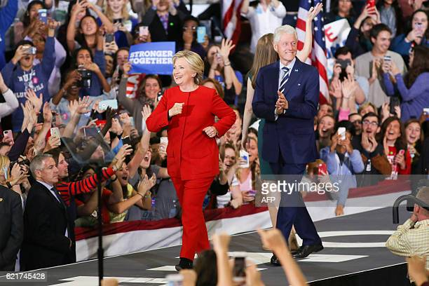 The Clinton family walks on stage inside the Reynolds Coliseum on the campus of North Carolina State University in Raleigh North Carolina on November...
