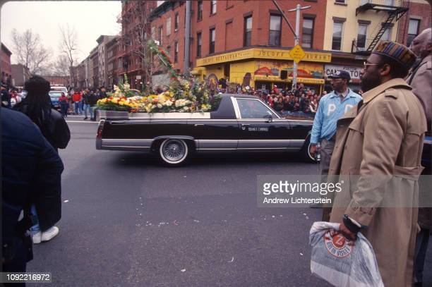 The Clinton Hill neighborhood where the rap star Christopher Wallace known as Biggie grew up comes out to watch his funeral procession drive by on...