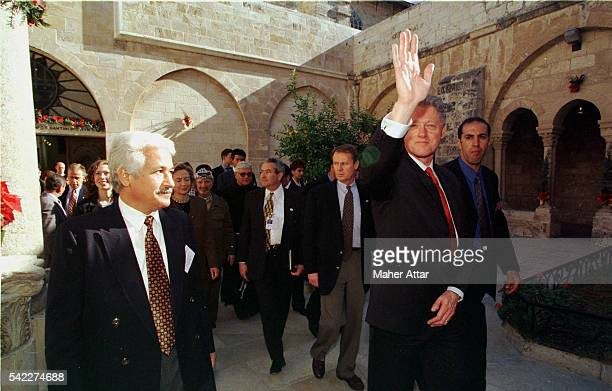 The Clintons as they leave the Basilica of the Nativity