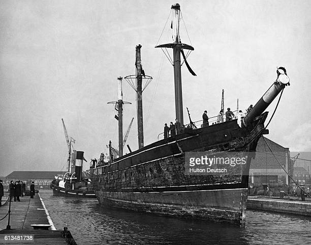 The clipper Cutty Sark enters the lock at East India Import Dock ready to start on her last voyage on which she will be towed to a permanent berth in...